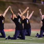 reach for the sky: The varsity dance team performs at halftime during the Homecoming Game on Sept. 28. The week prior, they were notified of the removal of lyrics in their music.